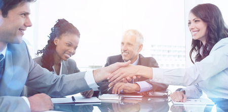 Young businesswoman and a coworker shaking hands during a meeting Stock Photo