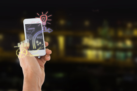 Male hand holding a smartphone against illuminated city by lake 3d