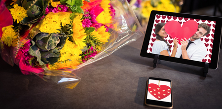 Cute heart decoration against technology with fresh colorful bouquet