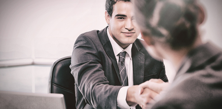 Manager interviewing a female applicant in his office Stockfoto