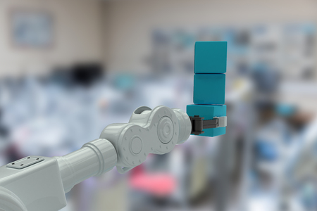 mano robotica: Cropped image of robotic hand holding stack of boxes against image of technology 3d