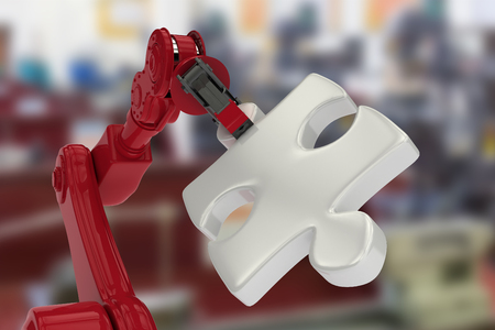 mano robotica: Closeup of red robotic hand with gray jigsaw piece against image of machinery 3d