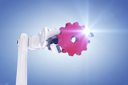 mano robotica: Cropped image of robotic hand holding red gear against purple vignette 3d Foto de archivo