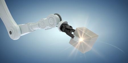 mano robotica: Cropped image of robotic hand holding metallic cube against purple vignette 3d