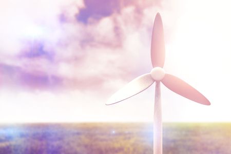 Wind mill against meadow land against sky 3d