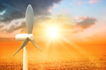 Vector image of wind mill against sunrise over field 3d