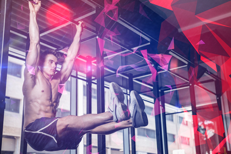 pull out: Shirtless man doing pull up at gym Stock Photo