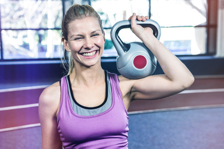 Portrait of woman holding kettlebell crossfit Stock Photo - 70128522