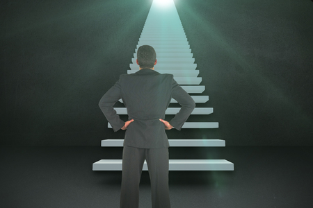 staircases: Businessman standing back to the camera with hands on hip  against black wall 3d