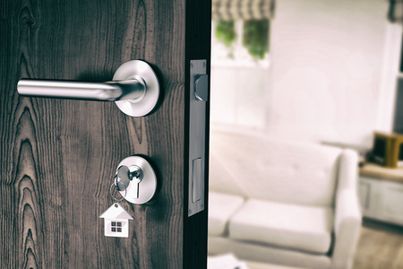 domicile: Digitally generated image of brown door with key against sitting room Stock Photo