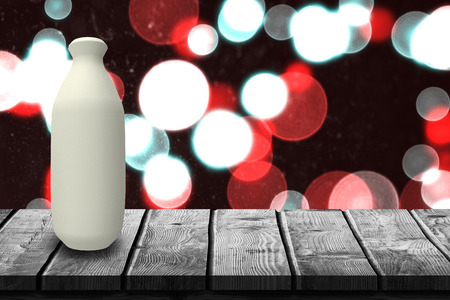 determined: Low angle view of plastic bottle against digitally generated twinkling light design 3d