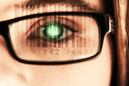 wearing spectacles: Composite image of Bar code  against eye of a woman wearing spectacles