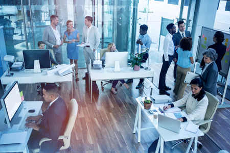 Business people interacting while working in office