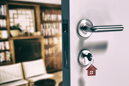 classy house: Digitally generated image of open door with house key against view of studio