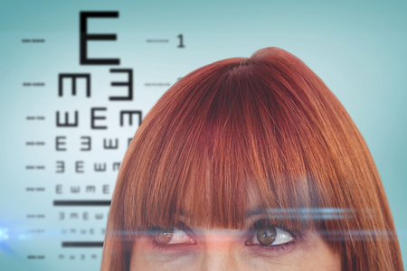 sense of sight: Red head woman with copy space against blue vignette background