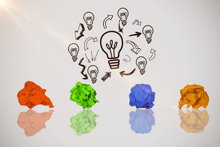 Yellow crumpled paper on white background against idea and innovation graphic
