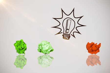 Close-up of green crumpled paper against idea and innovation graphic Stock Photo