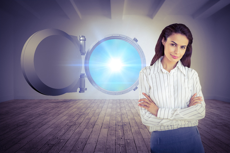 Young businesswoman in office against digital room