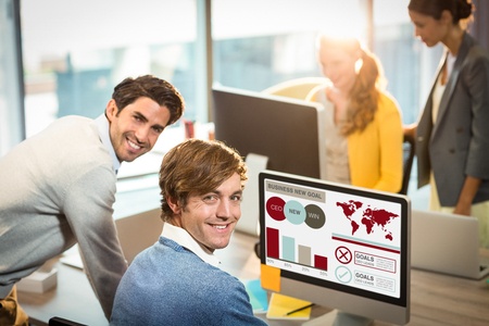 Composite image of business presentation with charts and text against businessmen smiling at office Stock Photo