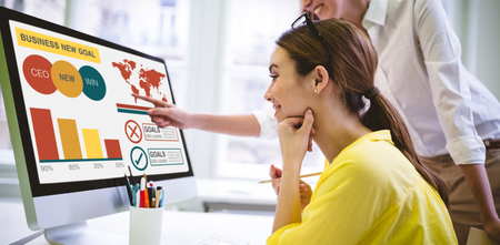 Digital composite image of business presentation with charts and text against women discussing over computer monitor Stock Photo