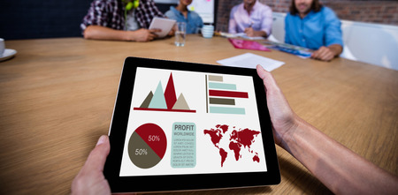 Digital composite image of business presentation against cropped image of man holding digital tablet Stock Photo