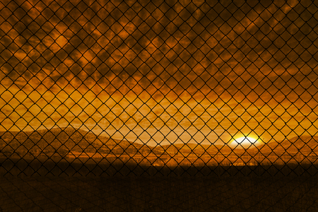 chainlink fence: Chainlink fence against  white background against beautiful african scene