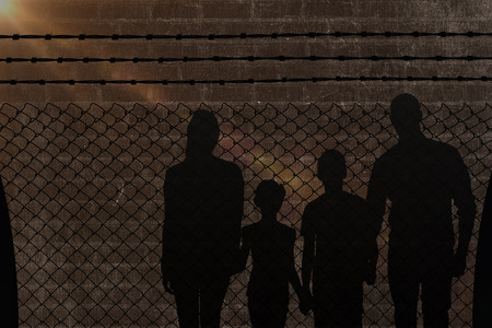 forbidden love: Portrait of happy family walking over white background against a dark wall