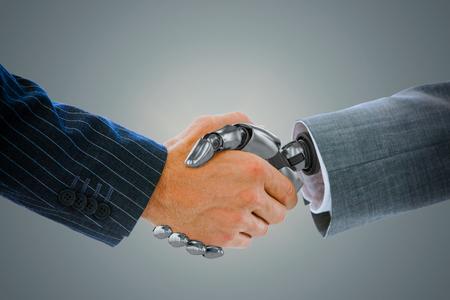 human hands: Cropped image of businessman shaking hand of robot against blue vignette background