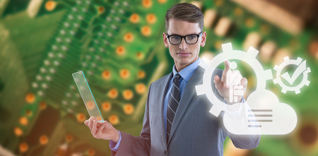 silicio: Businessman holding glass sheet and touching invisible screen against green printed circuit board