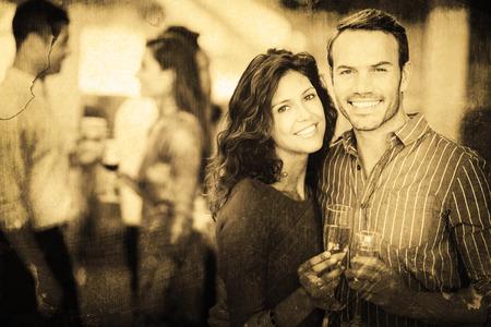 Grey background against romantic couple having drinks