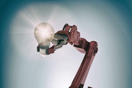 mano robotica: Illustrative image of robotic hand holding light bulb against grey vignette 3d Foto de archivo