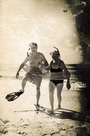 Grey background against senior couple enjoying on beach