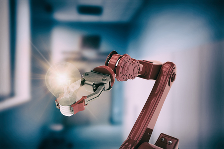 Composite image of red robotic arm holding light bulb against vacant corridor 3d