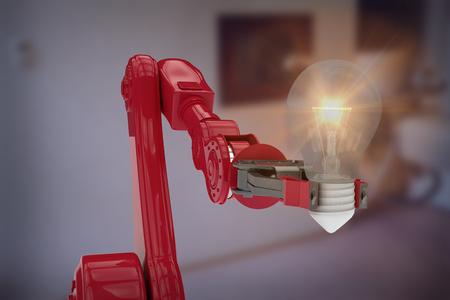 Illustrative image of robotic arm holding light bulb against modern examination room 3d Stock Photo