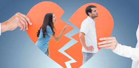 Angry brunette shouting at boyfriend against purple vignette Stock Photo