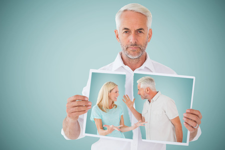 Unhappy couple having an argument  against blue background Stock Photo