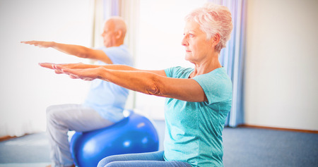 sheltered accommodation: Seniors using exercise ball in studio