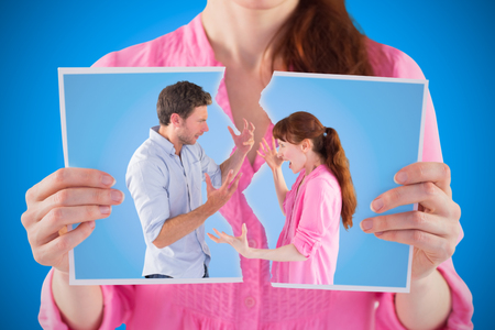 Couple arguing with each other against blue background