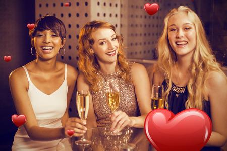 Portrait of friend having champagne against hearts