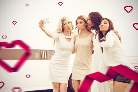Well dressed women taking selfie  against hearts