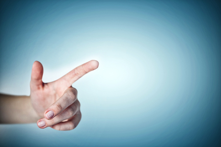 vignette: Close-up of cropped hand against grey vignette