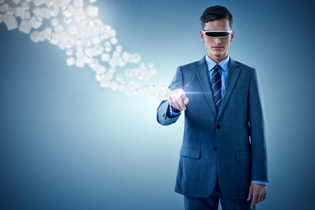 invisible: Businessman pointing while using virtual reality glasses against purple vignette 3d Stock Photo