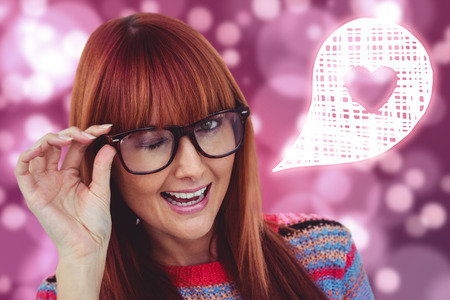 Smiling hipster woman doing wink against light glowing dots on pink
