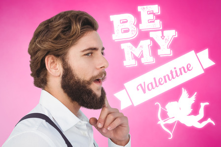 Thoughtful hipster with finger on chin against pink background