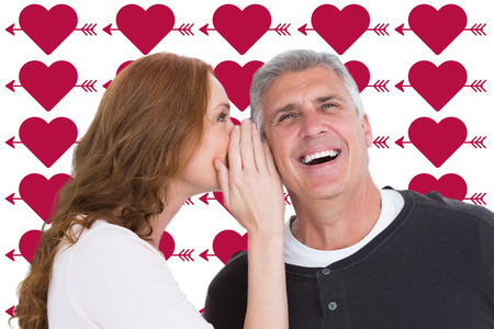 Woman telling secret to her partner against perforated heart symbols