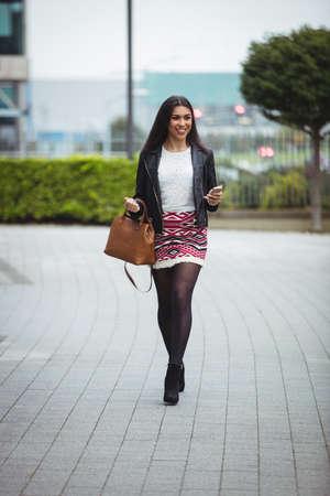 Happy woman walking in office premises