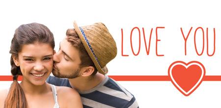 Man kissing woman against web