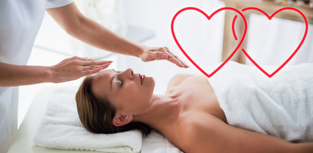 therapist performing reiki on woman Stock Photo