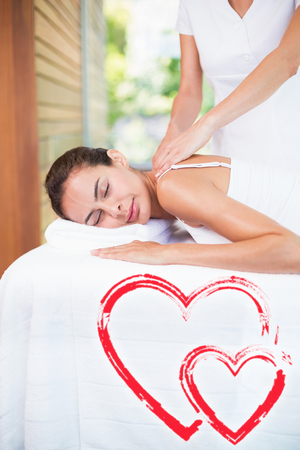 masseur massaging woman at health spa