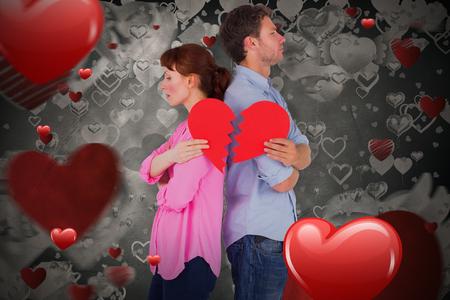 Couple holding a broken heart against love heart pattern 3D